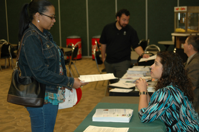 A student chats with Kathleen Kosmoski(right), OTC's Director for Resource Development, about joining the Ogeechee Tech Alumni Association, at the College's recent Graduation Gala.
